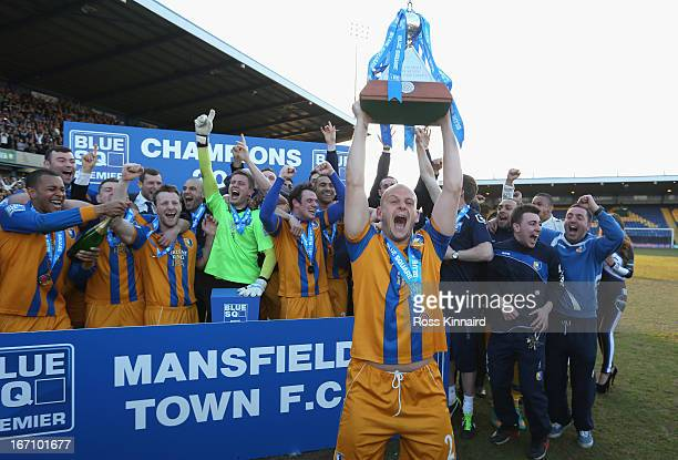 Adam Murray of Mansfield lifts the trophy as Mansfield celebrate after the Blue Square Bet Premier match between Mansfield Town and Wrexham at the...