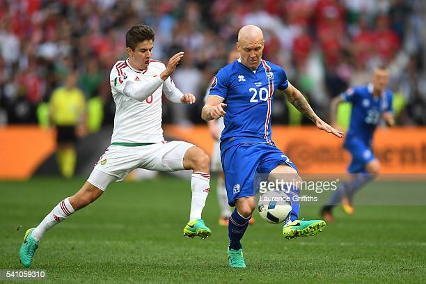 Adam Nagy of Hungary and Emil Hallfredsson of Iceland compete for the ball during the UEFA EURO 2016 Group F match between Iceland and Hungary at...