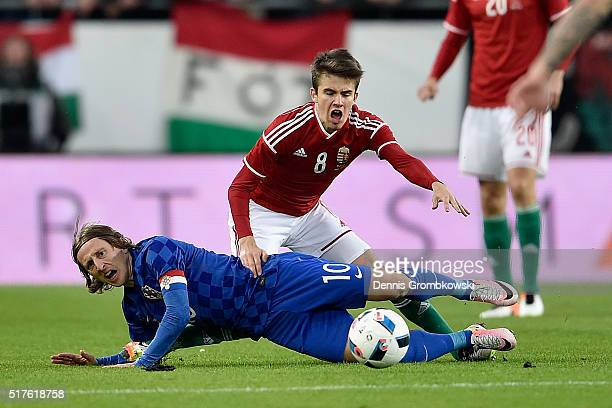 Adam Nagy of Hungary and Luka Modric of Croatia battle for the ball during the International Friendly match between Hungary and Croatia at Groupama...
