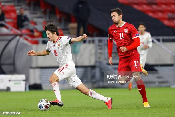 Adam Nagy of Hungary battles for possession with Marko Grujic of Serbia during the UEFA Nations League group stage match between Hungary and Serbia...