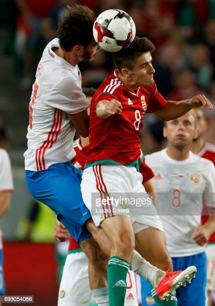 Adam Nagy of Hungary battles for the ball in the air with Aleksandr Erokhin of Russia during the International Friendly match between Hungary and...