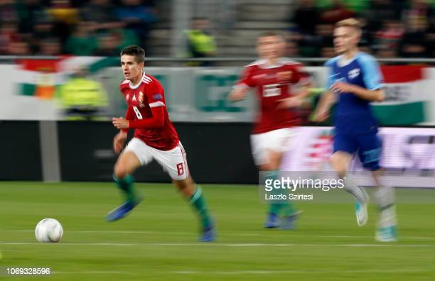 Adam Nagy of Hungary controls the ball before Willi Orban of Hungary and Jasse Tuominen of Finland during the UEFA Nations League group stage match...