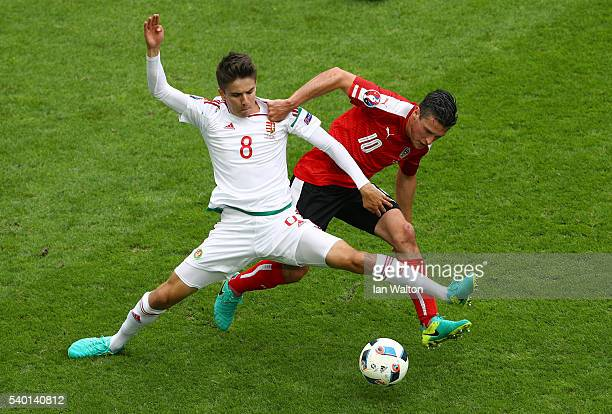 Adam Nagy of Hungary controls the ball under pressure of Zlatko Junuzovic of Austria during the UEFA EURO 2016 Group F match between Austria and...