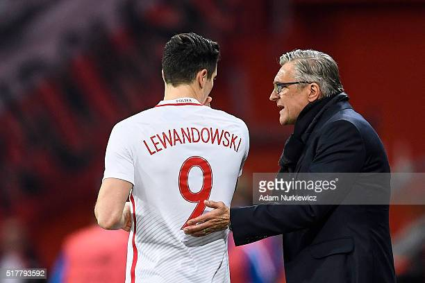 Adam Nawalka head coach and trainer of Poland talks to Robert Lewandowski both of Poland during the international friendly soccer match between...