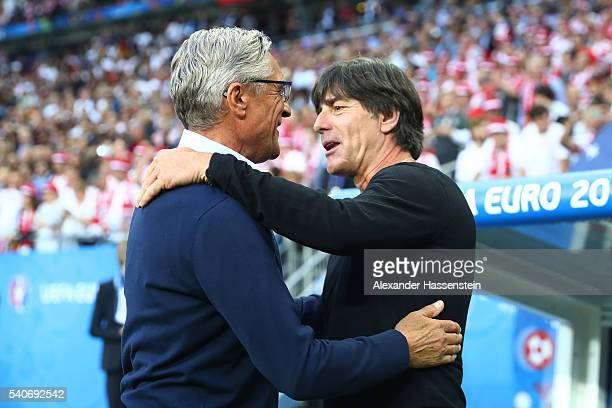 Adam Nawalka head coach of Poland and Joachim Loew head coach of Germany greet prior to the UEFA EURO 2016 Group C match between Germany and Poland...
