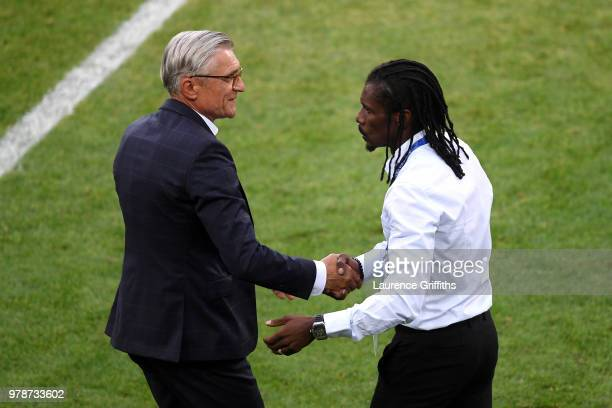 Adam Nawalka Head coach of Poland congratulates Aliou Cisse Head coach of Senegal following Senegal's victory in the 2018 FIFA World Cup Russia group...