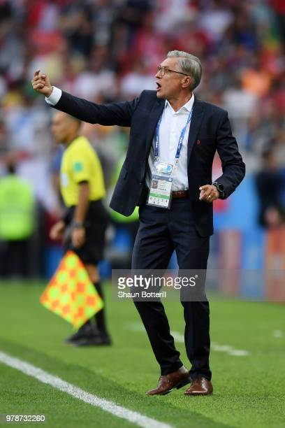 Adam Nawalka Head coach of Poland gives his team instructions during the 2018 FIFA World Cup Russia group H match between Poland and Senegal at...