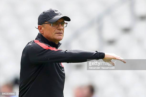 Adam Nawalka head coach of Poland gives instructions during a team Poland training session ahead of the UEFA EURO 2016 Group C match between Germany...