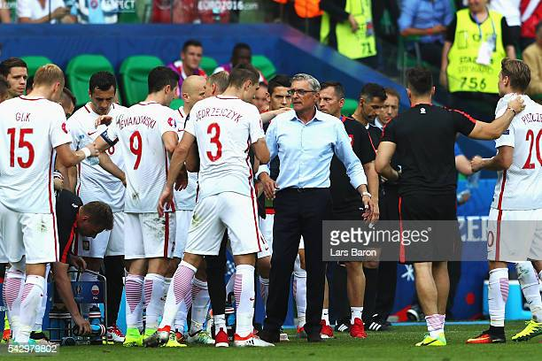 Adam Nawalka head coach of Poland instructs his players before the second half of the extra time during the UEFA EURO 2016 round of 16 match between...