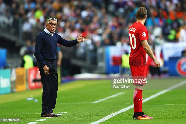 Adam Nawalka head coach of Poland instructs Lukasz Piszczek during the UEFA EURO 2016 Group C match between Germany and Poland at Stade de France on...