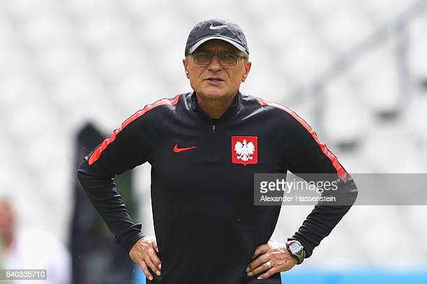 Adam Nawalka head coach of Poland looks on during a team Poland training session ahead of the UEFA EURO 2016 Group C match between Germany and Poland...