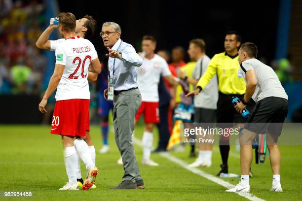 Adam Nawalka Head coach of Poland speaks to Lukasz Piszczek of Poland during the 2018 FIFA World Cup Russia group H match between Poland and Colombia...