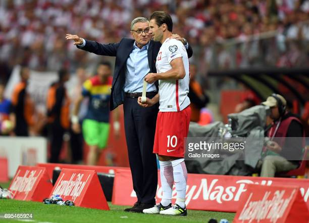 Adam Nawalka of Poland gives instructions to Grzegorz Krychowiak of Poland during the 2018 FIFA World Cup Russia eliminations match between Poland...