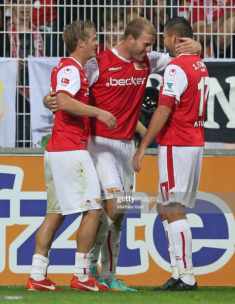 Adam Nemec (C) of Berlin jubilates with team mates after scoring the second goal during the Second Bundesliga match between 1.FC Union Berlin and Fortuna Duesseldorf at Stadion an der Alten Foersterei on August 19, 2013 in Berlin, Germany.
