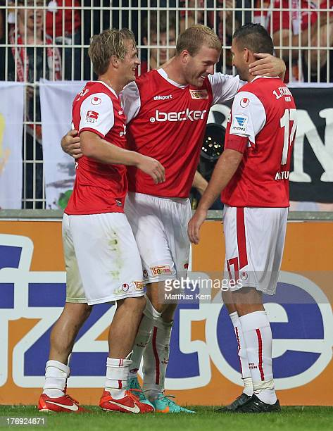 Adam Nemec of Berlin jubilates with team mates after scoring the second goal during the Second Bundesliga match between 1.FC Union Berlin and Fortuna...