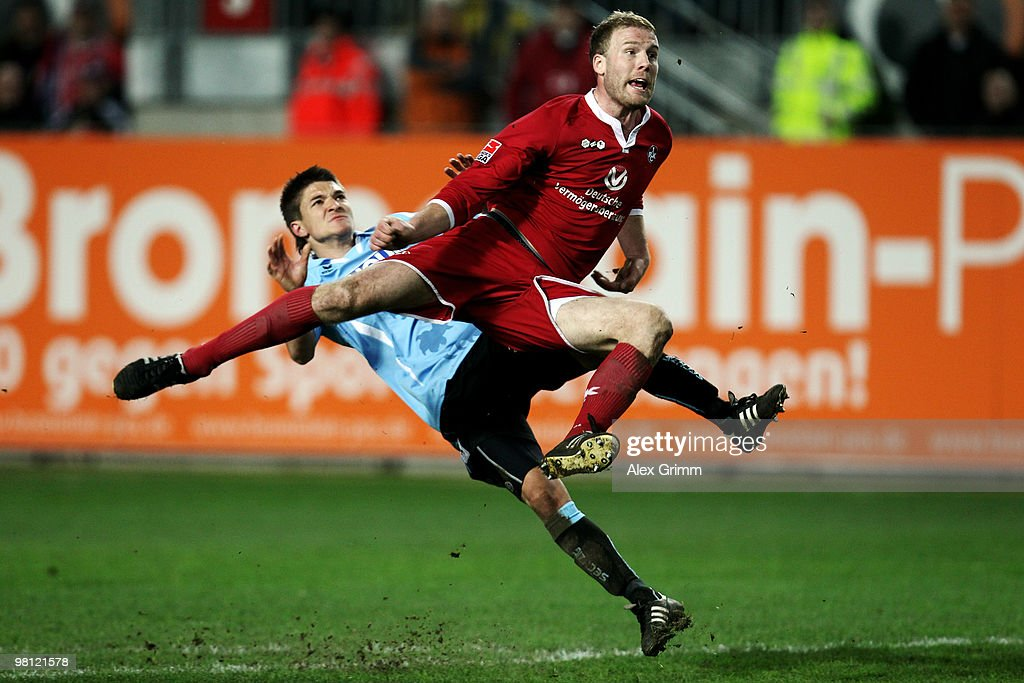 Adam Nemec (front) of Kaiserslautern is challenged by Aleksandar Ignjovski of Muenchen during the Second Bundesliga match between 1. FC Kaiserslautern and 1860 Muenchen at the Fritz-Walter Stadium on March 29, 2010 in Kaiserslautern, Germany.