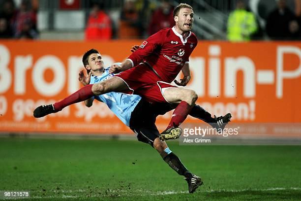 Adam Nemec of Kaiserslautern is challenged by Aleksandar Ignjovski of Muenchen during the Second Bundesliga match between 1 FC Kaiserslautern and...