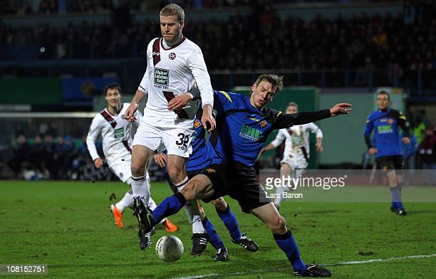 Adam Nemec of Kaiserslautern is challenged by Ole Kittner of Koblenz during the DFB Cup round of sixteen match between TuS Koblenz and 1 FC...