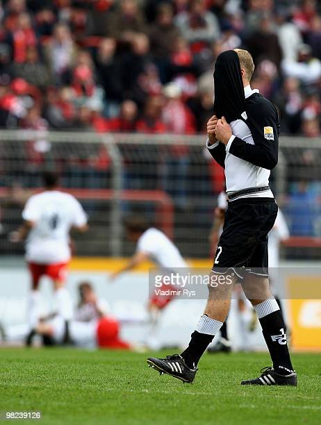 Adam Nemec of Kaiserslautern reacts as players of Oberhausen celebrate their second goal scored from a penalty kick by Markus Kaya during the Second...