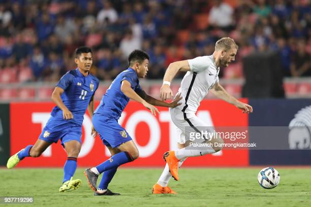 Adam Nemec of Slovakia dribbles the ball away from Thitiphan Puangjan of Thailand during the international friendly match between Thailand and...