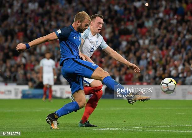 Adam Nemec of Slovakia shoots past Phil Jones of England during the FIFA 2018 World Cup Qualifier between England and Slovakia at Wembley Stadium on...