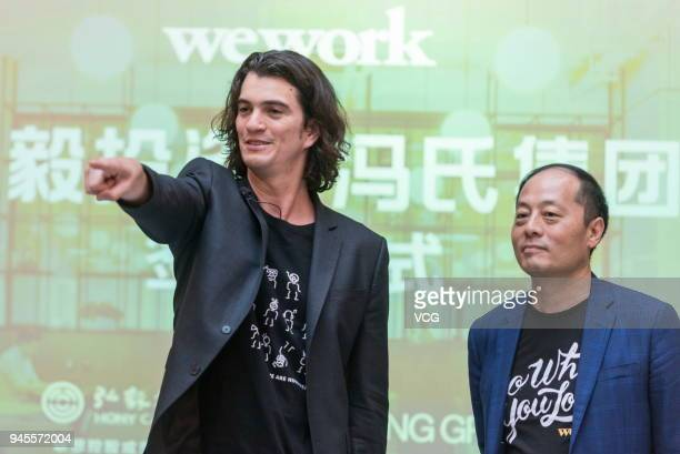 Adam Neumann cofounder chief executive officer of WeWork and John Zhao chief executive officer of Hony Capital Ltd attend a signing ceremony at...