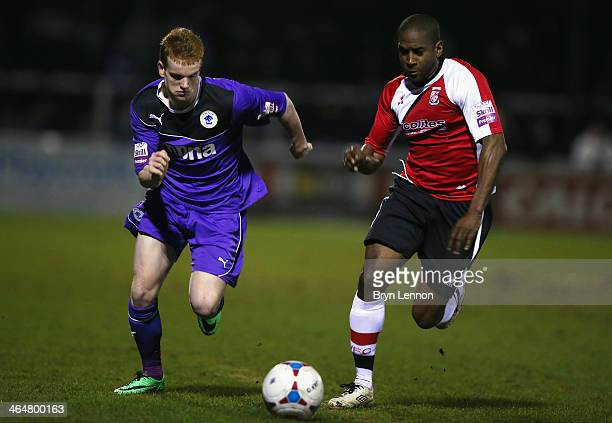 Adam Newton of Woking FC battles with Jamie Menagh of Chester City during the Skrill Conference Premier match between Woking and Chester at the...
