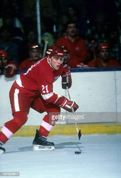 Adam Oates of the Detroit Red Wings skates with the puck during an NHL game against the New York Islanders circa 1988 at the Nassau Coliseum in...