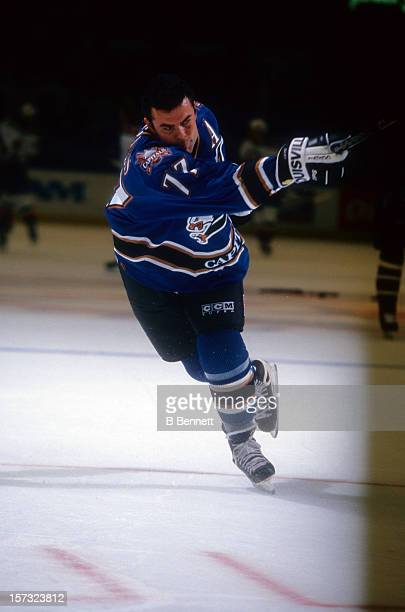 Adam Oates of the Washington Capitals takes a shot during warm-ups before an NHL game against the Buffalo Sabres on October 9, 1997 at the Marine...