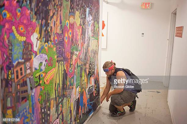 Adam O'Day adjusts the mount on a collaborative piece on Tuesday afternoon July 8 2014 in his former studio and residence in South Boston