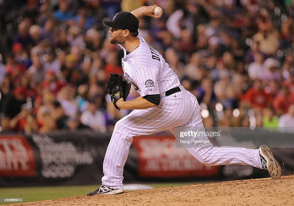 Adam Ottavino #0 of the Colorado Rockies delivers against the Cincinnati Reds at Coors Field on August 15, 2014 in Denver, Colorado. Ottavino collected the loss as the Red defeated the Rockies 3-2.