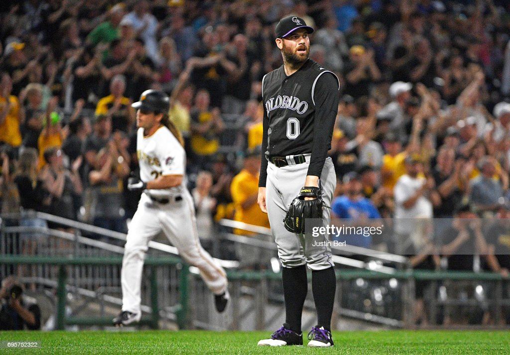 Adam Ottavino #0 of the Colorado Rockies reacts as John Jaso #28 of the Pittsburgh Pirates rounds the bases after hitting a two run home run in the seventh inning during the game at PNC Park on June 13, 2017 in Pittsburgh, Pennsylvania.