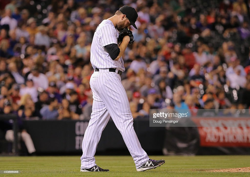 Adam Ottavino #0 of the Colorado Rockies returns to the mound as he works against the Cincinnati Reds at Coors Field on August 15, 2014 in Denver, Colorado. Ottavino collected the loss as the Red defeated the Rockies 3-2.