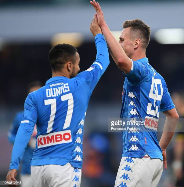 Adam Ounas and Arkadiusz Milik of SSC Napoli celebrate the 30 goal scored by Arkadiusz Milik during the Serie A match between SSC Napoli and...