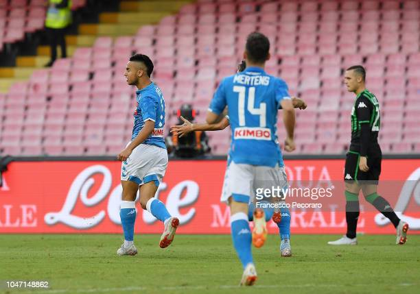 Adam Ounas and Dries Mertens of SSC Napoli celebrate the 10 goal scored by Adam Ounas beside the disappointment of Pol Lirola of US Sassuolo during...