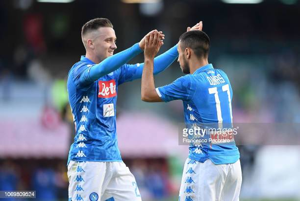 Adam Ounas and Piotr Zielinski of SSC Napoli celebrate the 20 goal scored by Adam Ounas during the Serie A match between SSC Napoli and Frosinone...