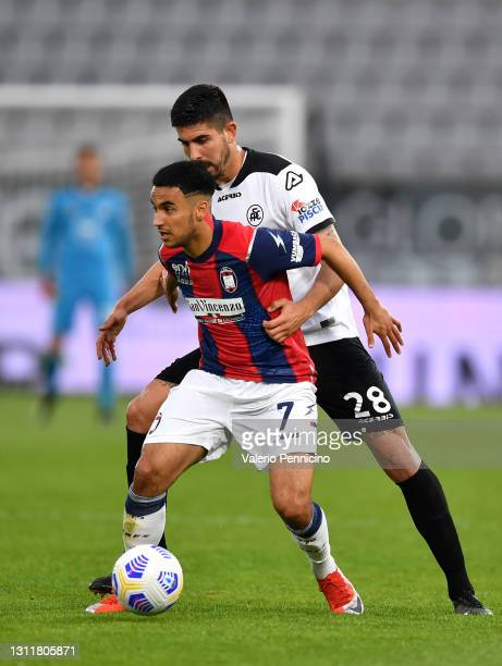 Adam Ounas of F.C. Crotone and Martin Erlic of Spezia battle for the ball during the Premier League match between Liverpool and Aston Villa at...