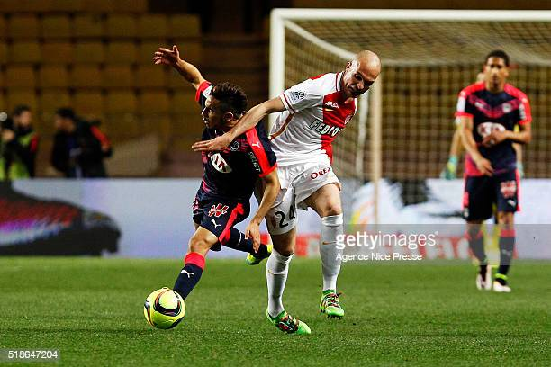 Adam Ounas of FCG Bordeaux and Andrea Raggi of AS Monaco during the French Ligue 1 match between As Monaco and Girondins de Bordeaux at Louis II...