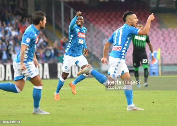 Adam Ounas of Napoli celebrates after scoring the first goal during the Serie A match between SSC Napoli and US Sassuolo at Stadio San Paolo on...