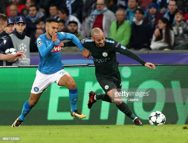 Adam Ounas of Napoli competes for the ball with David Silva of Manchester City during the UEFA Champions League group F match between SSC Napoli and...