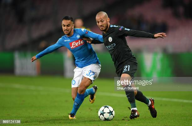 Adam Ounas of SSC Napoli and David Silva of Manchester City battle for possession during the UEFA Champions League group F match between SSC Napoli...