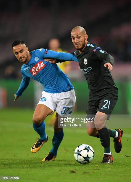 Adam Ounas of SSC Napoli and David Silva of Manchester City battle for posession during the UEFA Champions League group F match between SSC Napoli...