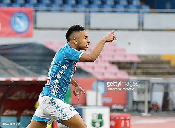 Adam Ounas of SSC Napoli celebrates after scoring the 10 goal during the Serie A match between SSC Napoli and US Sassuolo at Stadio San Paolo on...