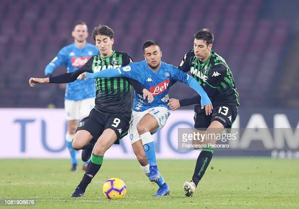 Adam Ounas of SSC Napoli vies Federico Peluso and Filip Djuricic of US Sassuolo during the Coppa Italia match between SSC Napoli and US Sassuolo at...