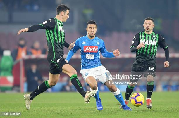 Adam Ounas of SSC Napoli vies Federico Peluso of US Sassuolo during the Coppa Italia match between SSC Napoli and US Sassuolo at Stadio San Paolo on...