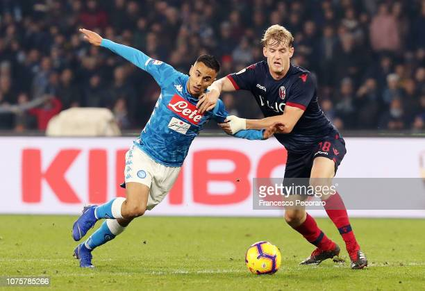 Adam Ounas of SSC Napoli vies Filip Helander of Bologna FC during the Serie A match between SSC Napoli and Bologna FC at Stadio San Paolo on December...