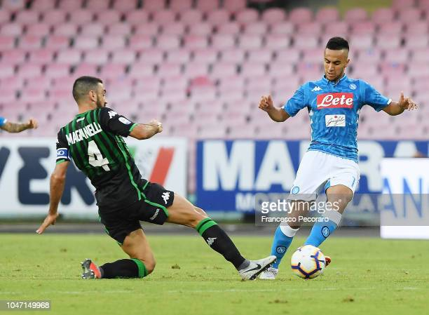 Adam Ounas of SSC Napoli vies Francesco Magnanelli of US Sassuolo during the Serie A match between SSC Napoli and US Sassuolo at Stadio San Paolo on...