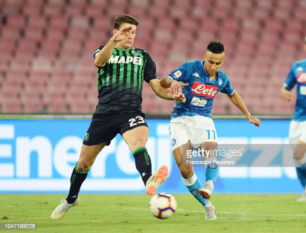 Adam Ounas of SSC Napoli vies Giangiacomo Magnani of US Sassuolo during the Serie A match between SSC Napoli and US Sassuolo at Stadio San Paolo on...
