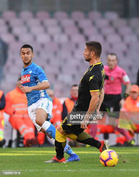 Adam Ounas of SSC Napoli vies Marco Capuano of Frosinone Calcio during the Serie A match between SSC Napoli and Frosinone Calcio at Stadio San Paolo...