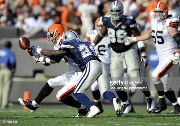 Adam pacman Jones of the Dallas Cowboys knoscs aay a pass intended for Braylon Edwards of the Cleveland Browns at Cleveland Browns Stadium on...